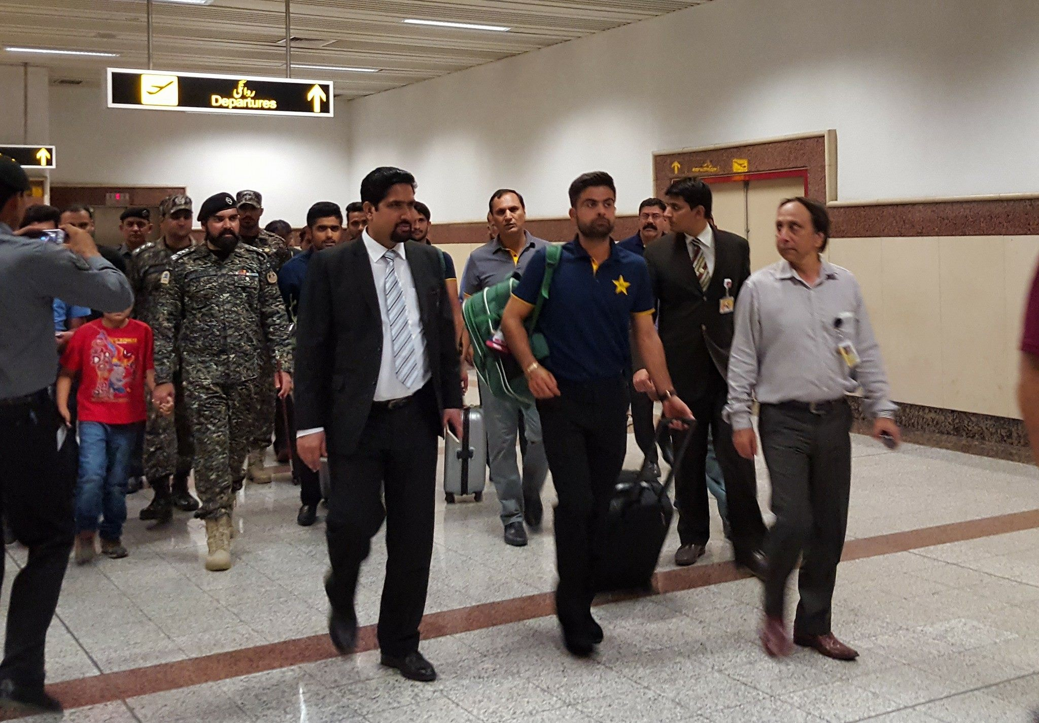 Pakistan News - Ahmad Shahzad Coming Out of Airport