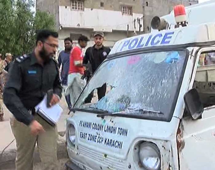 Three cops, child shot dead in attack on Karachi police