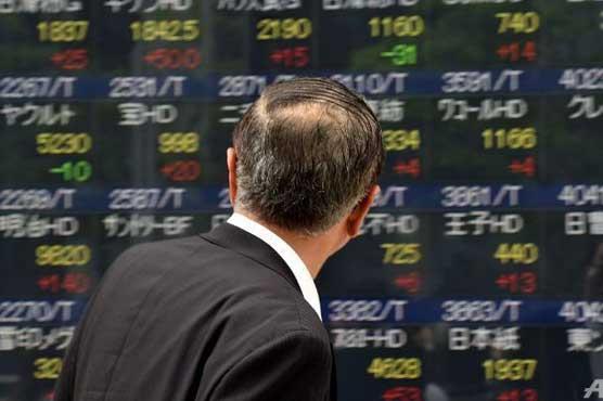 World stocks hit one-year peak, dollar sags on weak US data