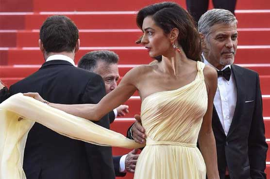 Reports suggest divorce between Clooney, Amal almost done