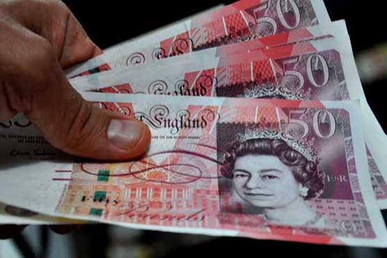British pound jumps, shares fall as Bank of England keeps rates unchanged