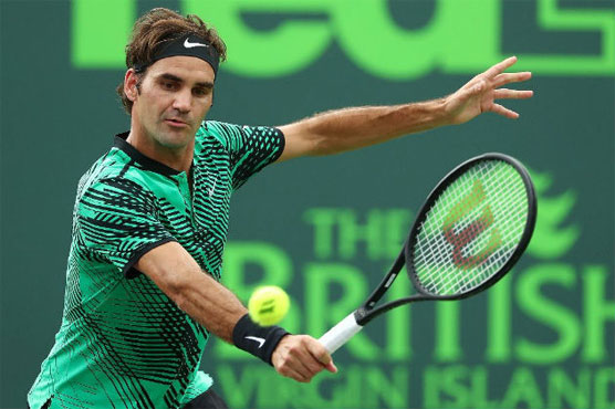 Federer survives Berdych threat in Miami