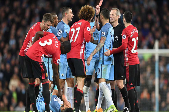 Football: Fellaini sent off as United, City draw blank