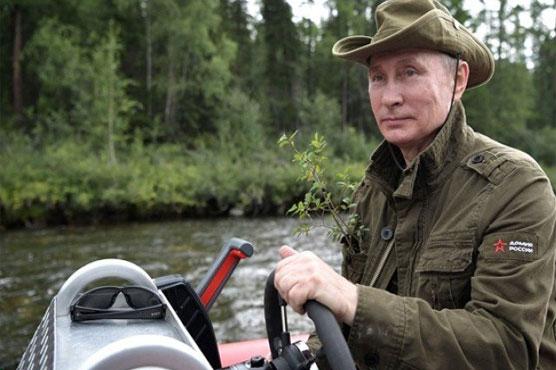 Gone fishing: Russia's Putin bares chest on Siberian lake trip