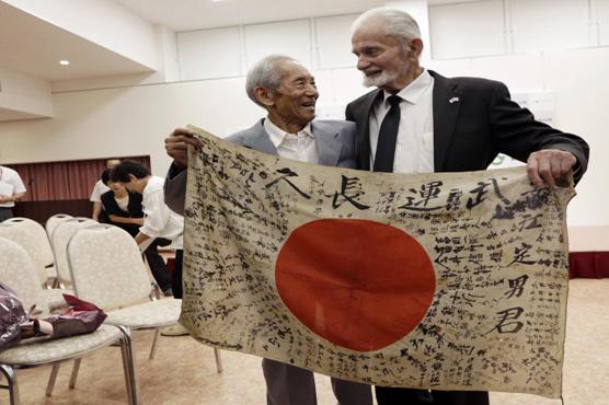 USA vet returns dead Japanese soldier's flag to grateful kin