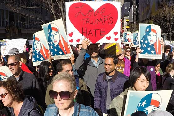 Protesters rally in New York's Times Square against Donald Trump's immigration policies