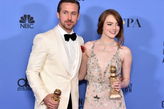 'La La Land' waltzes to big victory at Golden Globes