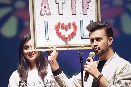 VIDEO: A fan girl comes up on stage to meet Atif Aslam during concert