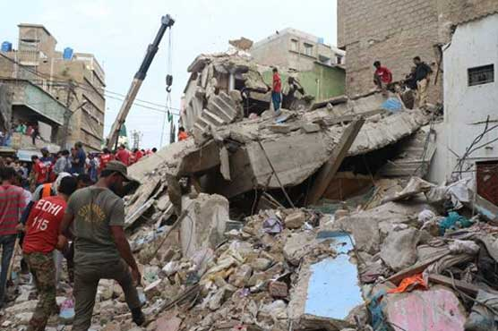 Rescue work under way in Karachi locality after building caves in