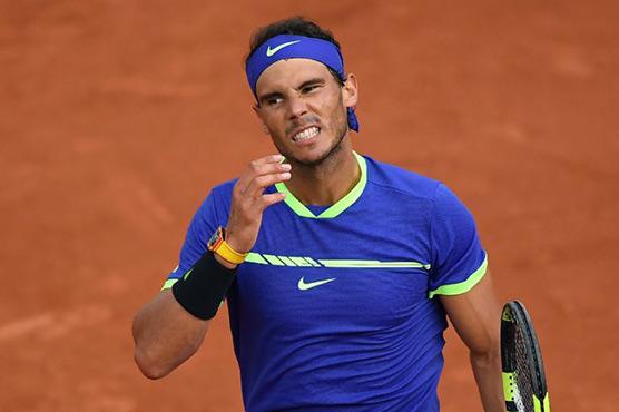 Nadal merciless as Djokovic toils in Paris