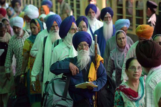 Sikh pilgrims stage protest as India stops them at Attari station