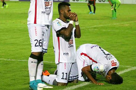 Football players make statement about religious harmony while celebrating goal