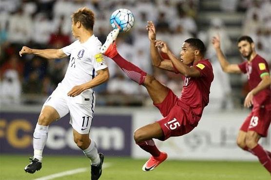 Football: Late blows jolt China, Qatar shock South Korea