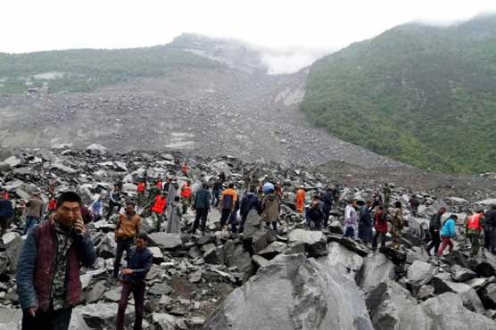 15 bodies found after landslide buries scores in China
