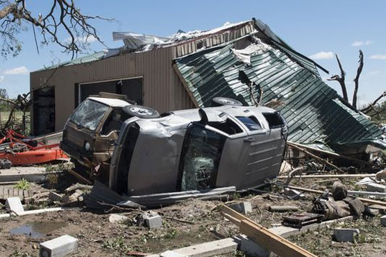 Tornadoes and floods kill at least 14 people in US