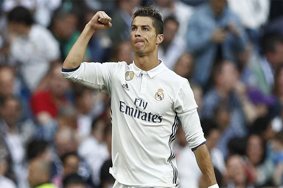 Football: Real Madrid, Barca set up final day title showdown