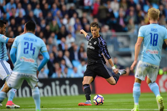 Football: Ronaldo double puts Madrid within point of title