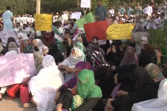 Teachers, PTI workers protest outside Imran's Bani Gala residence
