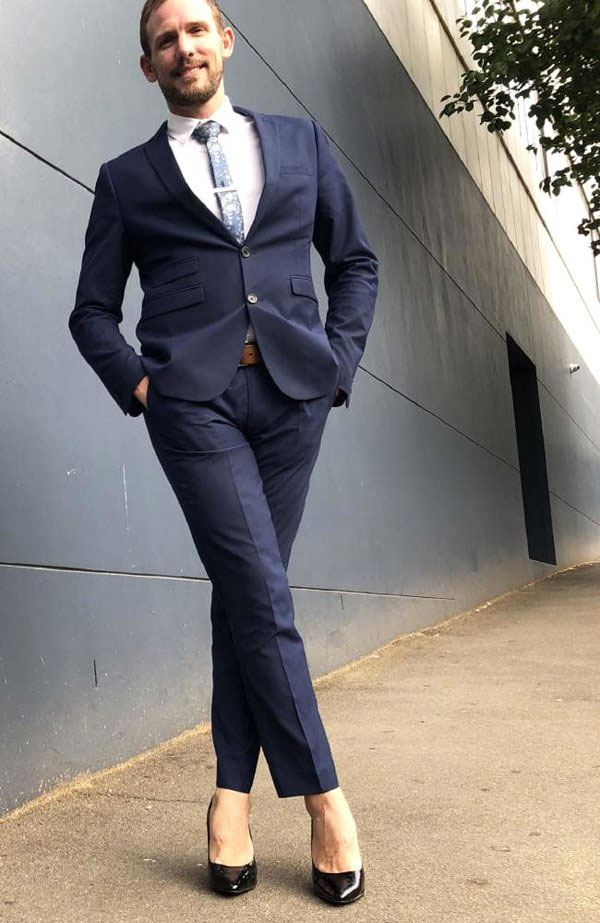 man who wears high heels to office