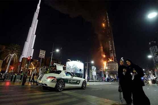 'One hour, then that's it': Dubai fire survivor hangs from balcony