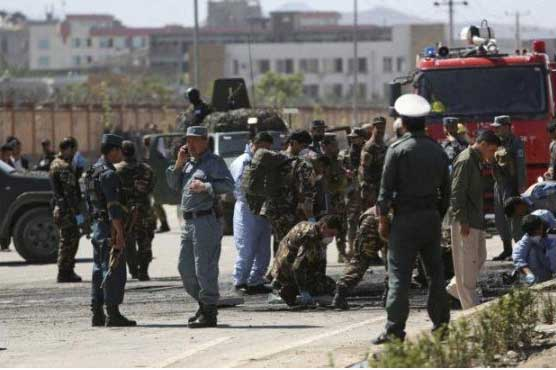 Suicide bombers kill 27, wound 40 in attack on Afghan police