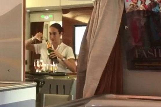 Emirates flight attendant pours champagne back into bottle