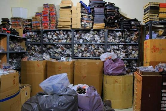 Abu Dhabi authorities confiscate fake shoes and bags
