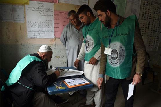 Gunmen kidnap Afghan election staff, burn voter documents