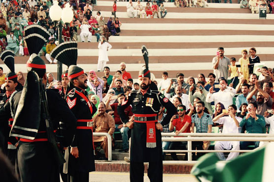 Pakistan cricketer Hasan Ali performs his signature celebration at Wagah Border