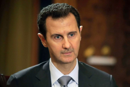 Turkey says Assad must go 'at some point'