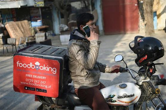 Afghan delivery men feel pressure as online sales rise