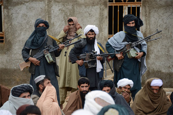 Afghan officials and Taliban talk despite wave of violence
