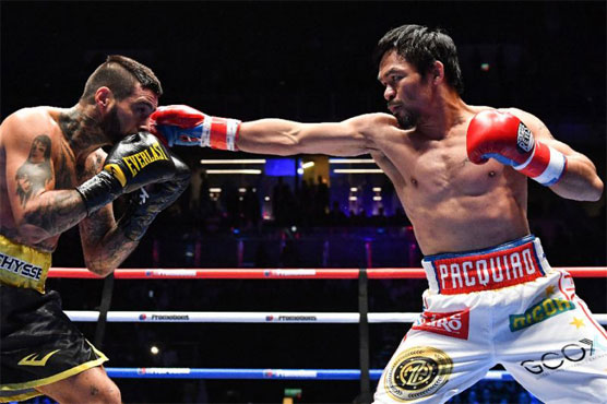 Pacquiao wins 60th career fight with seventh-round knockout
