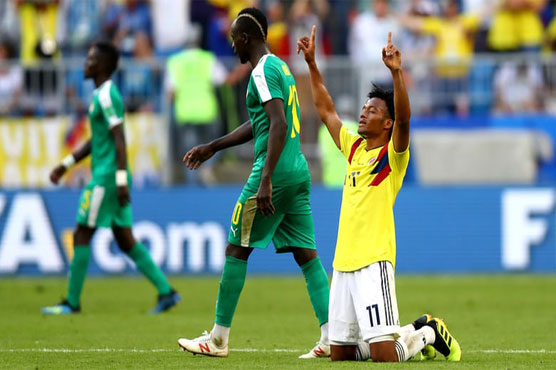 Mina sends Colombia through as ill-disciplined Senegal exit World Cup