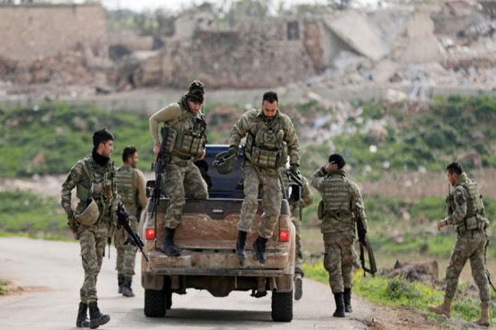 Turkish forces 'surround' Syrian Kurdish city