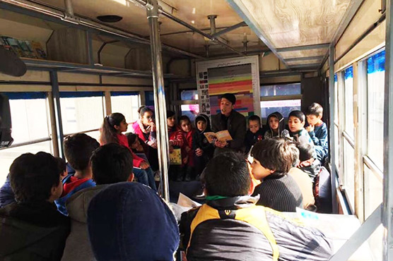 Climb on board: Afghan woman brings stories to Kabul's children