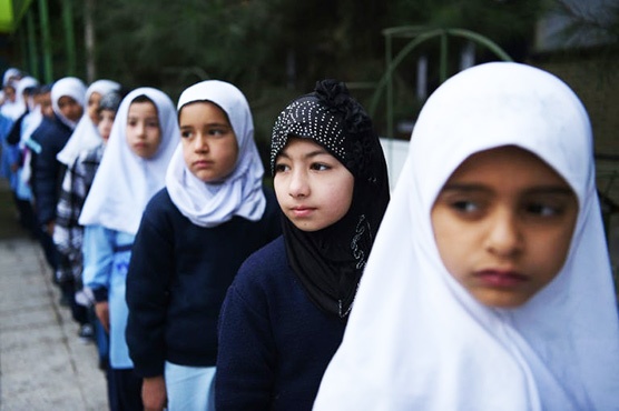 Afghan children back in the classroom as violence stalks the school run