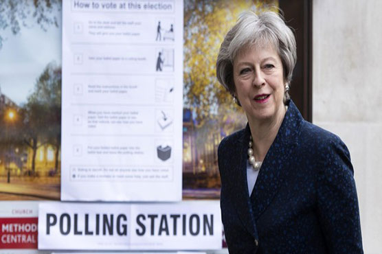 May does better than expected in England local elections