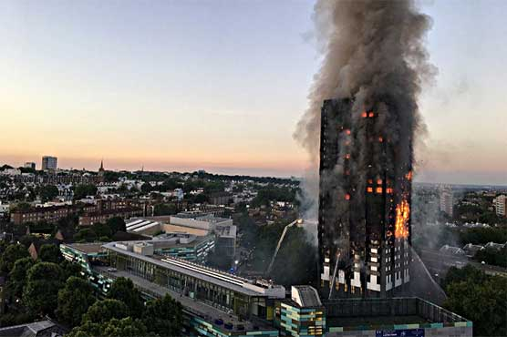 UK PM bows to pressure on deadly tower block fire inquiry