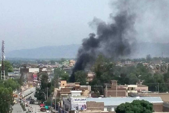 At least ten dead after bomb, gun battle in Afghan city