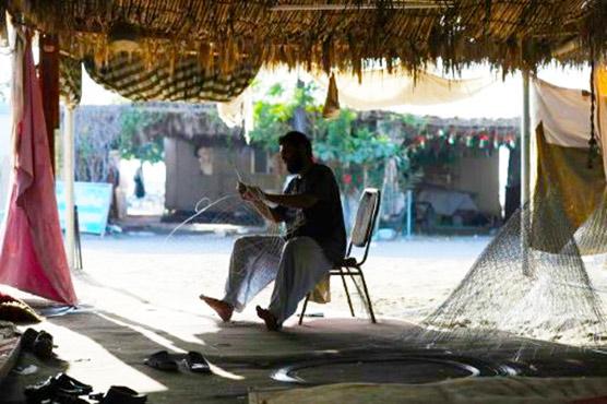 Afghans, Pakistanis weave a livelihood on Emirati coast