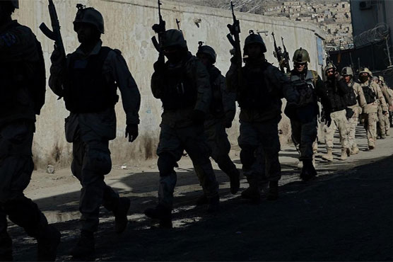 Taliban battle Afghan government forces in western city near Iran