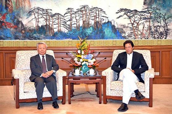President AIIB calls on PM Imran Khan in Beijing