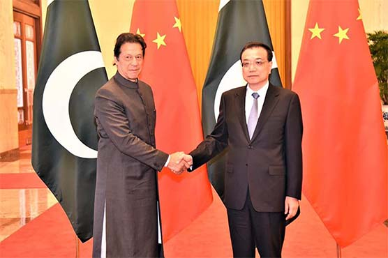 With eye on aid, PM Khan meets Chinese counterpart