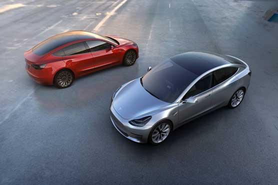 Tesla meets Model 3 target, bemoans China tariffs