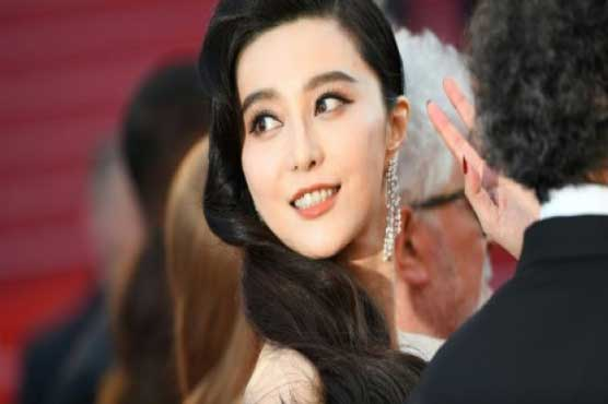 China punishes taxmen who investigated superstar Fan