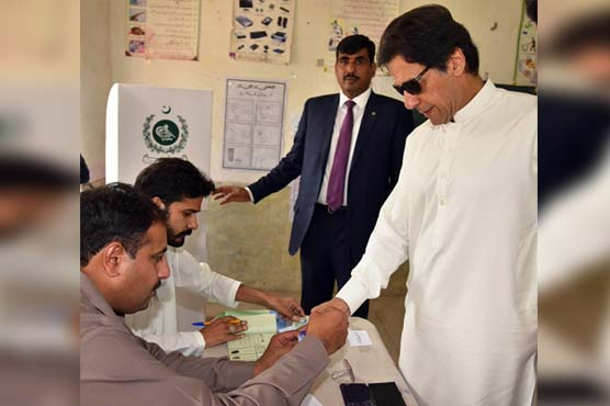 By-Elections: PM Imran, other politicians cast votes at different polling stations