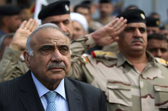 Iraq's embattled PM bows out as protesters mourn dead