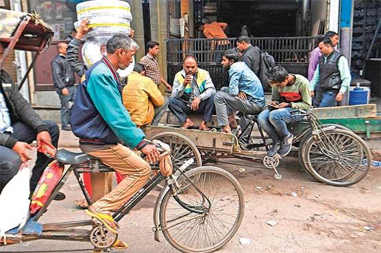 India's poor fight desperate battle to find work as slowdown bites