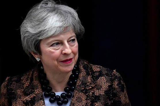 May says to seek 'pragmatic' Brexit solution in Brussels